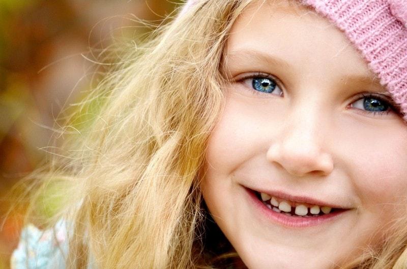 portrait-of-happy-girl-wearing-knit-hat-min
